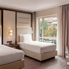 Отель Hilton Munich City Германия, Мюнхен - 9 отзывов об отеле, цены и фото номеров - забронировать отель Hilton Munich City онлайн комната для гостей фото 2