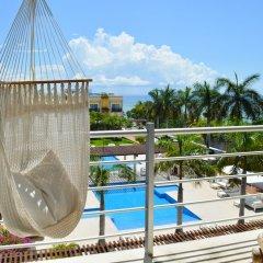 Отель Luxury Condos at Magia Мексика, Плая-дель-Кармен - отзывы, цены и фото номеров - забронировать отель Luxury Condos at Magia онлайн балкон