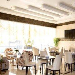 Отель Al Salam Grand Hotel-Sharjah ОАЭ, Шарджа - отзывы, цены и фото номеров - забронировать отель Al Salam Grand Hotel-Sharjah онлайн питание фото 2