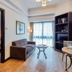 Апартаменты Orange Grove Service Apartment by ST Residences комната для гостей