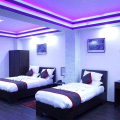 Отель Alpine Hotel & Apartment Непал, Катманду - отзывы, цены и фото номеров - забронировать отель Alpine Hotel & Apartment онлайн комната для гостей фото 3