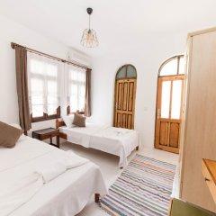 Отель Old Kalamaki Pansiyon Калкан комната для гостей фото 3