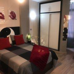 Апартаменты Namaste Apartment Торремолинос комната для гостей фото 2