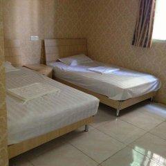 Апартаменты Xiamen Yiqing Apartment Сямынь комната для гостей фото 2