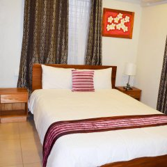 Апартаменты Al-Minhaj Service Apartments комната для гостей фото 3