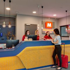 Отель MEININGER Hotel Munich Olympiapark Германия, Мюнхен - отзывы, цены и фото номеров - забронировать отель MEININGER Hotel Munich Olympiapark онлайн интерьер отеля