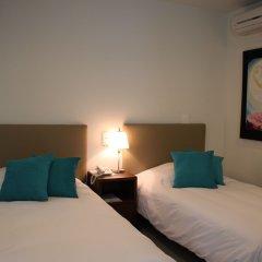 Отель Suites Chapultepec Мексика, Гвадалахара - отзывы, цены и фото номеров - забронировать отель Suites Chapultepec онлайн комната для гостей фото 5