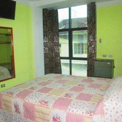 Ari's Hotel III комната для гостей