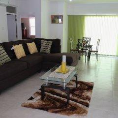 Отель Secure New Kingston Condo Ямайка, Кингстон - отзывы, цены и фото номеров - забронировать отель Secure New Kingston Condo онлайн комната для гостей фото 3