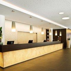 Отель NH Collection Dresden Altmarkt Германия, Дрезден - 5 отзывов об отеле, цены и фото номеров - забронировать отель NH Collection Dresden Altmarkt онлайн интерьер отеля фото 3