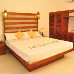 Отель Oasey Beach Resort Шри-Ланка, Бентота - отзывы, цены и фото номеров - забронировать отель Oasey Beach Resort онлайн комната для гостей фото 5