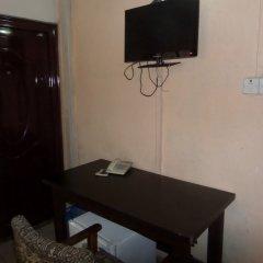 Отель Maxton Suites Magodo сейф в номере