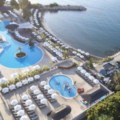 Отель The Royal Apollonia бассейн