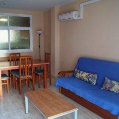 Отель Apartaments Costamar Испания, Калафель - 1 отзыв об отеле, цены и фото номеров - забронировать отель Apartaments Costamar онлайн комната для гостей фото 3