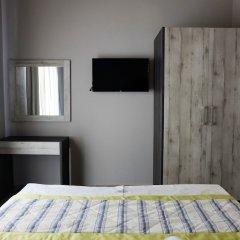 Апартаменты Paramithi Luxury Apartments сейф в номере