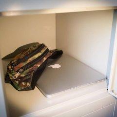 Отель EasyFlat Accommodation сейф в номере