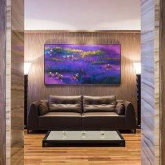 Отель The Reverie Saigon Residential Suites Вьетнам, Хошимин - отзывы, цены и фото номеров - забронировать отель The Reverie Saigon Residential Suites онлайн комната для гостей фото 2