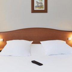 Отель Hôtel Kyriad Saint Quentin en Yvelines - Montigny Франция, Монтиньи ле Бретоне - отзывы, цены и фото номеров - забронировать отель Hôtel Kyriad Saint Quentin en Yvelines - Montigny онлайн комната для гостей