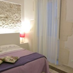 Апартаменты Cuccìa Apartment Сиракуза комната для гостей фото 2