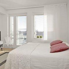 Отель Kotimaailma Espoo Runoratsu Финляндия, Эспоо - отзывы, цены и фото номеров - забронировать отель Kotimaailma Espoo Runoratsu онлайн комната для гостей