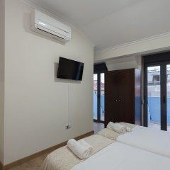 Отель Universo Romântico Guesthouse & Spa сейф в номере