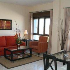 Отель Apartamentos Luxsevilla Palacio Испания, Севилья - отзывы, цены и фото номеров - забронировать отель Apartamentos Luxsevilla Palacio онлайн комната для гостей