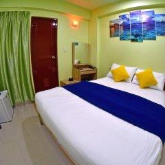 Отель Tourist Inn Мале комната для гостей фото 3