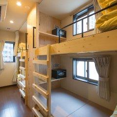 Nekokura Hostel Фукуока комната для гостей