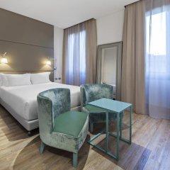 Отель NH Milano Touring 4* Улучшенный номер разные типы кроватей фото 38