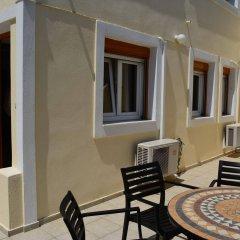 Отель Anemomilos Suites Греция, Остров Санторини - отзывы, цены и фото номеров - забронировать отель Anemomilos Suites онлайн балкон