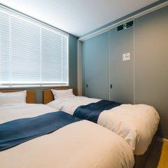 Отель Trip Base HAKATAEKIMAE Хаката комната для гостей фото 4