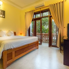 Отель Loc Phat Homestay Хойан комната для гостей