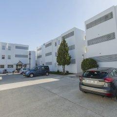 Отель Apartamentos Habitat парковка