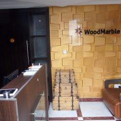 Отель The Woodmarble Hotels удобства в номере фото 2