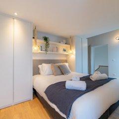 Апартаменты Sweet Inn Apartments - Petit Sablon Брюссель комната для гостей