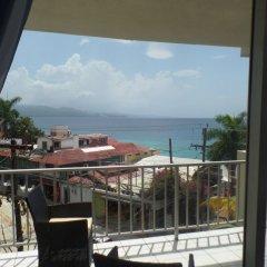 Отель Montego Bay Club Beach Resort Ямайка, Монтего-Бей - отзывы, цены и фото номеров - забронировать отель Montego Bay Club Beach Resort онлайн балкон