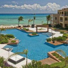Encanto El Faro Luxury Ocean Front Condo Hotel Плая-дель-Кармен бассейн