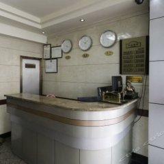 Huilong Hotel в номере