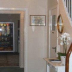 Отель Ansgarhus Motel Дания, Оденсе - отзывы, цены и фото номеров - забронировать отель Ansgarhus Motel онлайн интерьер отеля