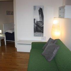 Апартаменты Apartment via Maironi da Ponte Бергамо комната для гостей фото 3
