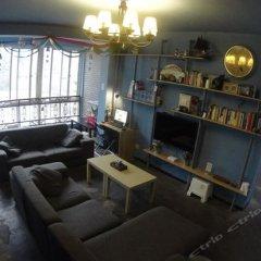 Chengdu Xinyi Youth Hostel комната для гостей фото 3