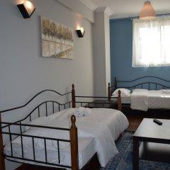 Отель Athenian Modern Apartment Mavili Square Греция, Афины - отзывы, цены и фото номеров - забронировать отель Athenian Modern Apartment Mavili Square онлайн комната для гостей