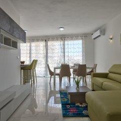 Отель First Class Apartments Calleja by G&G Мальта, Буджибба - отзывы, цены и фото номеров - забронировать отель First Class Apartments Calleja by G&G онлайн комната для гостей фото 5