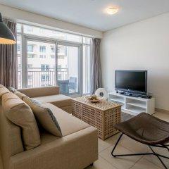Апартаменты One Perfect Stay - Studio at Burj Views Дубай комната для гостей фото 5
