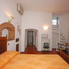 Отель A La Casa Dei Potenti Италия, Сан-Джиминьяно - отзывы, цены и фото номеров - забронировать отель A La Casa Dei Potenti онлайн сейф в номере