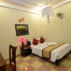Отель Nhi Nhi Хойан комната для гостей