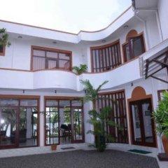Отель Riverside Inn Fuji Шри-Ланка, Бентота - отзывы, цены и фото номеров - забронировать отель Riverside Inn Fuji онлайн вид на фасад
