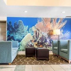 Отель Comfort Suites Seven Mile Beach Каймановы острова, Севен-Майл-Бич - отзывы, цены и фото номеров - забронировать отель Comfort Suites Seven Mile Beach онлайн интерьер отеля
