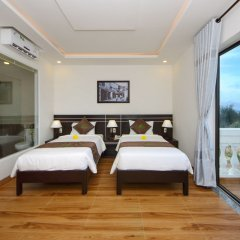 Отель Viet Long Hoi An Beach Hotel Вьетнам, Хойан - отзывы, цены и фото номеров - забронировать отель Viet Long Hoi An Beach Hotel онлайн комната для гостей фото 2