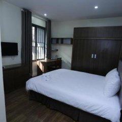 Отель Suji Residence Ханой сейф в номере